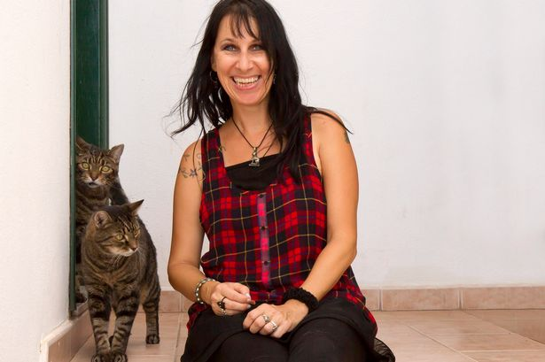 Barbarella Buchner with her two cats Spider and Lugosi