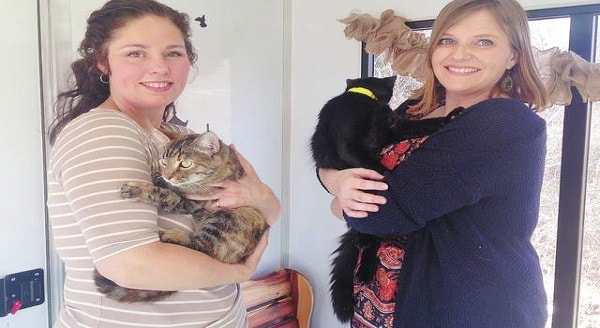 Amy Trenary and Nicole Walker with two of Eva's Eden's foster cats. (Staff photo by Savanna Walker)