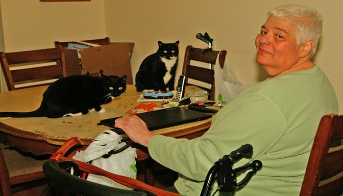 Elizabeth Colaianni with her two cats, Rocky and Mickey.