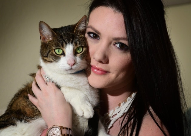 Adrienne Hamilton reunited with her cat Claudia. Picture: ANTONY KELLY