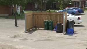 The garbage collection area where neighbours believe the kittens were abandoned. (Waubgeshig Rice/CBC)