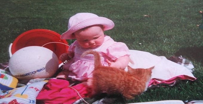 Caitlin McClelland as a child with her cats