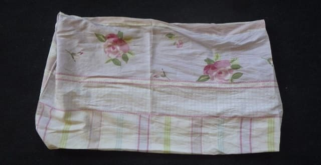 A pillow case with a floral design was used to tie up by the kitten. Credit: RSPCA