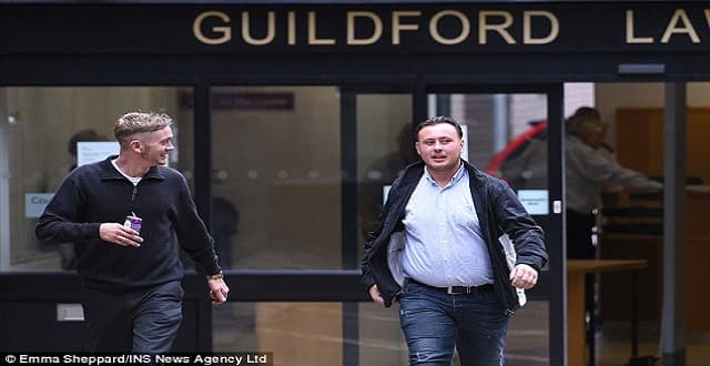 Leaving court: Mills (pictured right) denied causing criminal damage and possessing a firearm