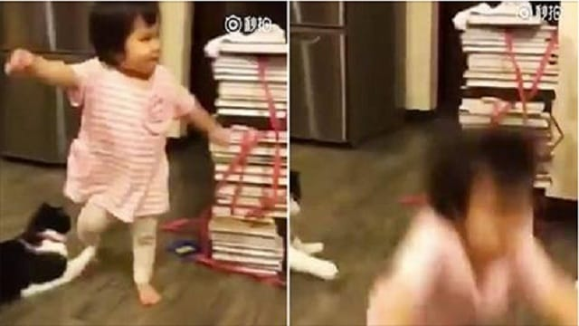Hilarious Moment Family Cat Trips Toddler by Grabbing Her Leg as She Walks Past!